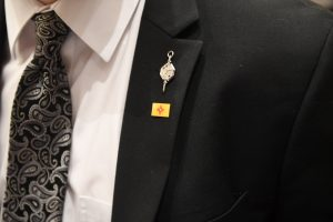 Suit and tie with Honor Society Pin