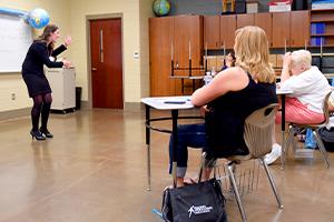 Teacher instructing in a class